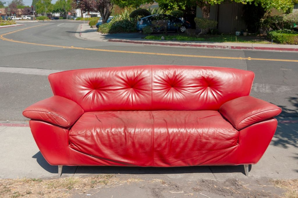 Abandoned red couch on the street