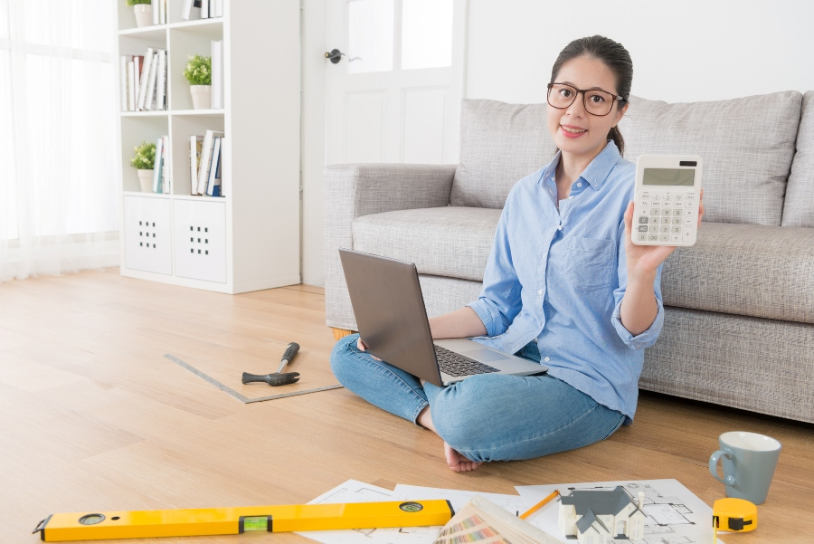 Housewife using computer planning house remodeling